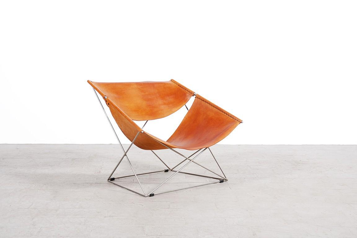 fauteuil papillon cuir fashion designs. Black Bedroom Furniture Sets. Home Design Ideas